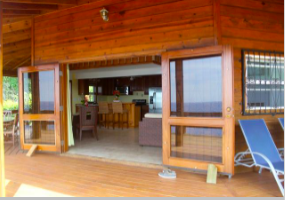 A huge deck, partly covered, to sit and watch the sunrises and the ocean.