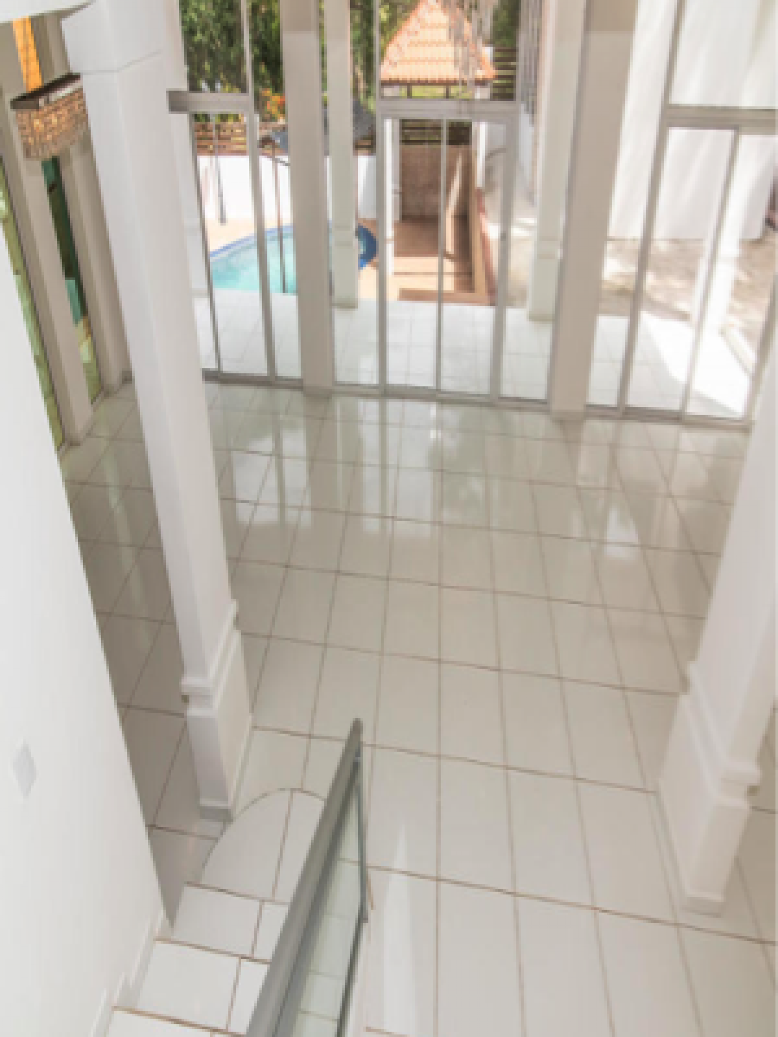 View of living area and pool area from stairs