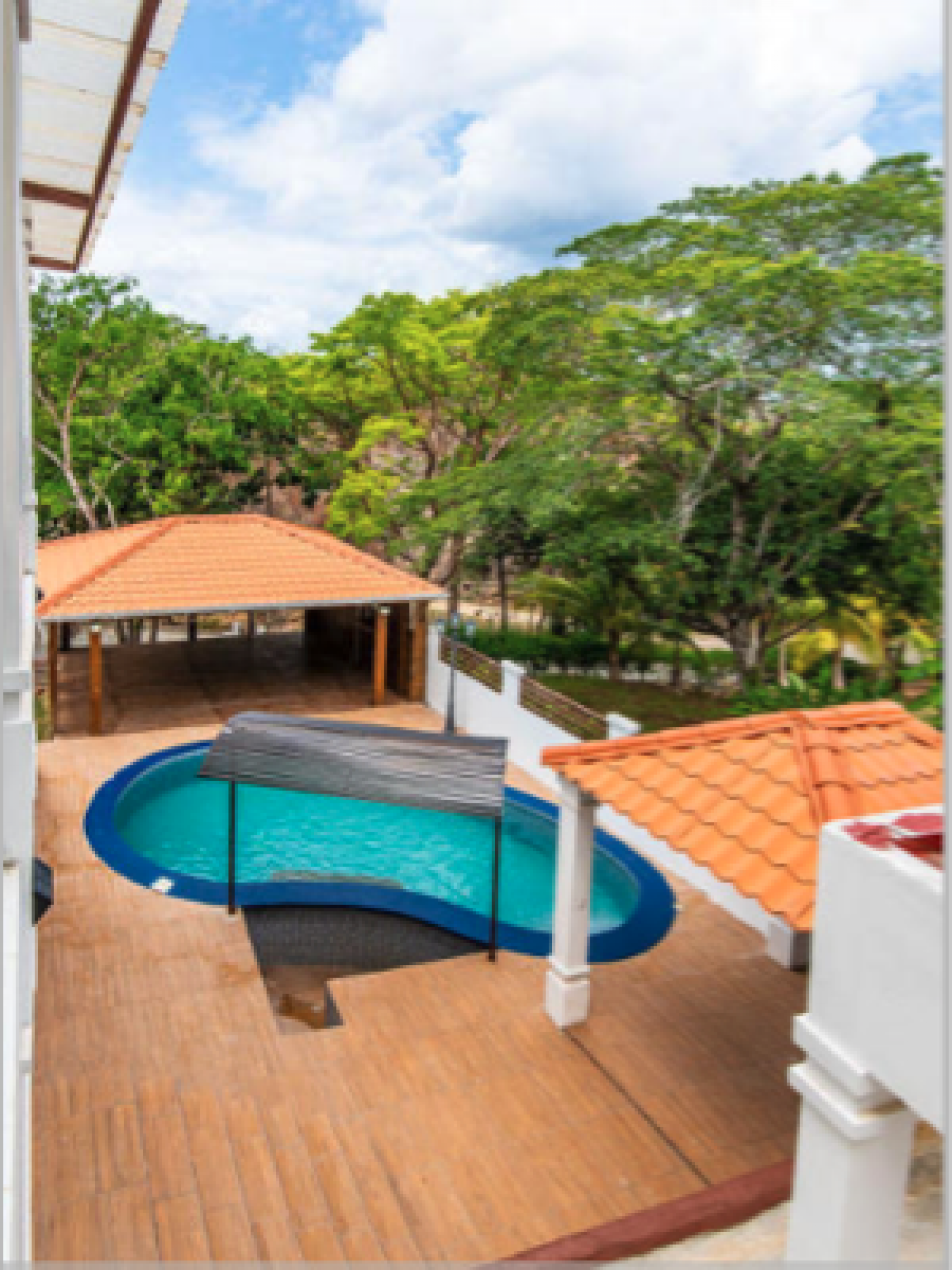 View of pool area from the upstairs veranda