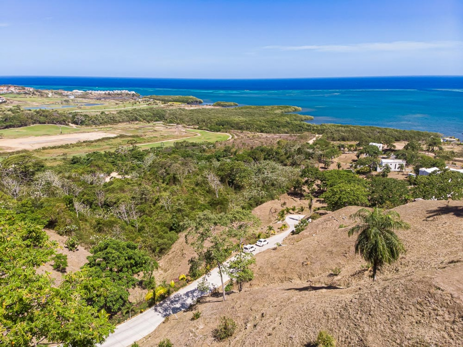 Homesite Ocean views Gated community Beach.   Adjacent to Pristine Bay golf course,  Close to amenities Landscape